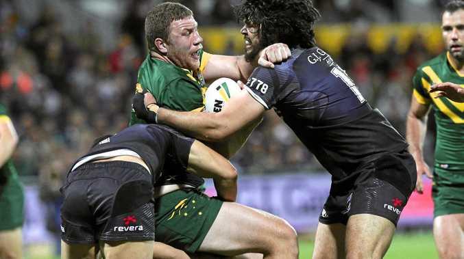Kangaroos forward Shannon Boyd is tackled by Jordan Kahu and Tohu Harris of the Kiwis.