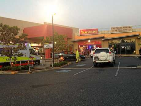 Emergency services at the scene of a single vehicle crash in the carpark out the front of Drakes IGA in Glenmore.
