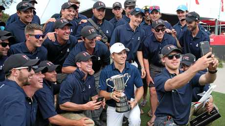 Jordan Speith  poses for a photograph with the greenkeepers after winning the Australian Open.