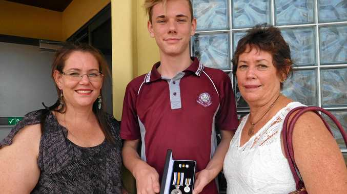 Queensland Police Service Sergeant Douglas Helmore's grand daughter Tanya Sutton, great grandson Riley Sutton and daughter Sandra Jones with his National Police Service Medal awarded at a ceremony in Rockhampton on November 16, 2016. Mrs Jones accepted the medal on behalf of her father who retired in 1980 and has since died.