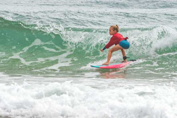SURF'S UP: Harper Smales shows off skills for Saint Thomas More during the Walk on Water team surfing competition.