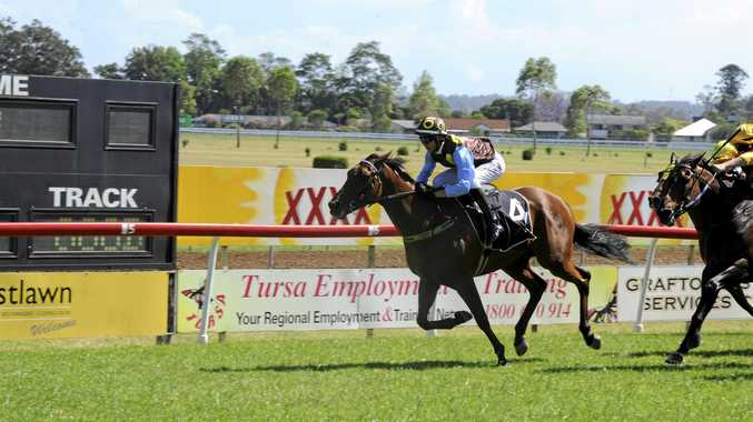 Gold Coast apprentice Jed Hodge storms home on Toby Edmonds-trained mare Flaming Aces to win the Christmas Cup (1200m) at the Clarence River Jockey Club.