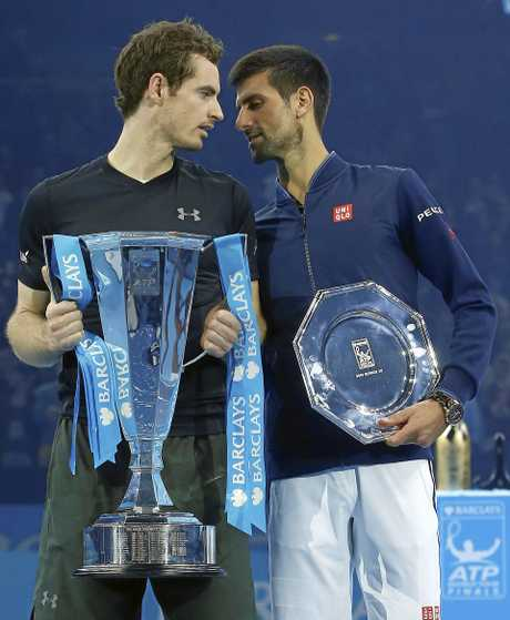 Andy Murray of Britain (left) speaks to Novak Djokovic of Serbia after winning the ATP World Tour Finals.