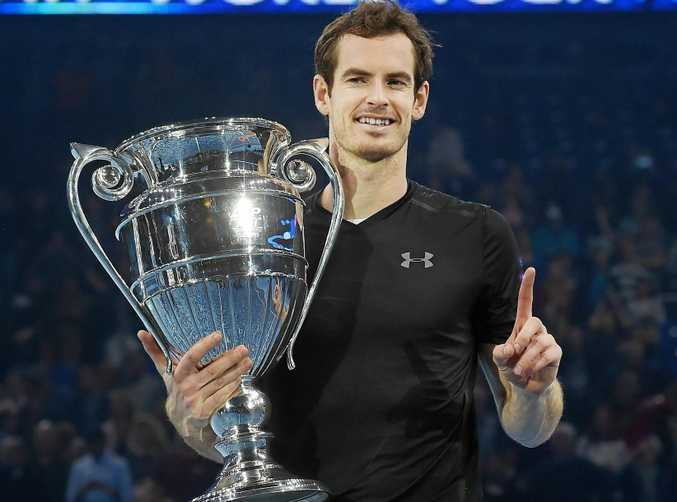 Britain's Andy Murray holds up the ATP world No.1 trophy following his win over Novak Djokovic in the men's singles final at the ATP World Tour Finals at the O2 Arena in London.