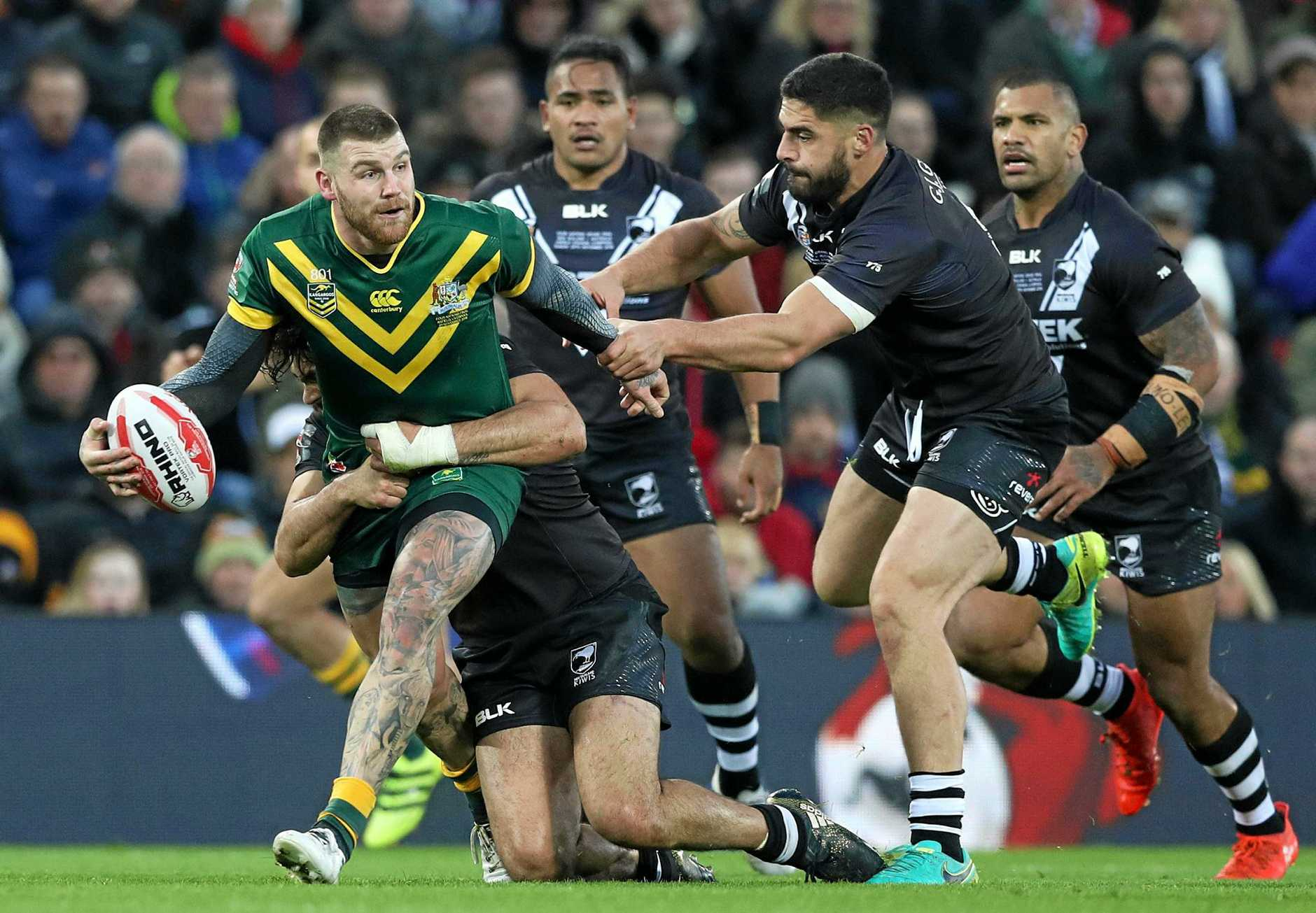 Australia's Josh Dugan looks to offload during the Four Nations final.