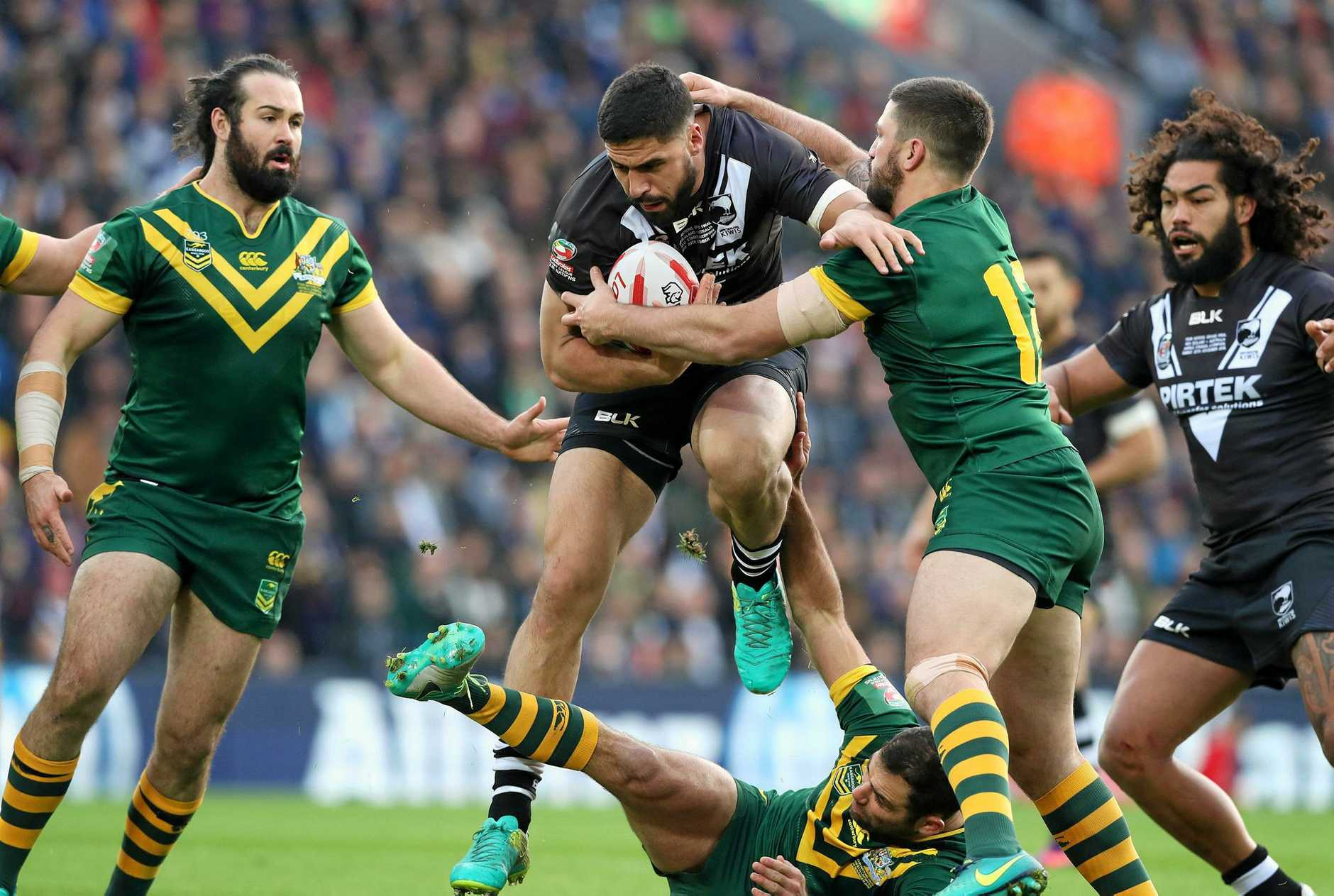 New Zealand's Jesse Bromwich is surrounded by Australia's Aaron Woods, Trent Merrin and Cameron Smith during the final of the Four Nations.