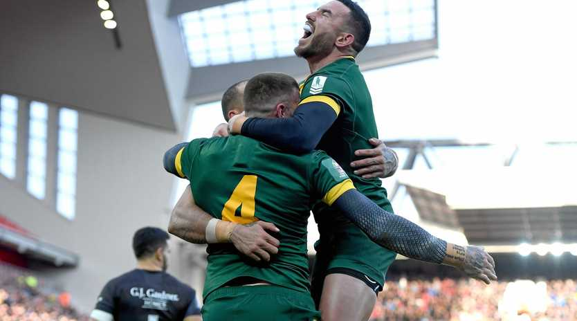 Darius Boyd (right) congratulates Kangaroos teammate Josh Dugan after Dugan scored his team's second try during the Four Nations final at Anfield.