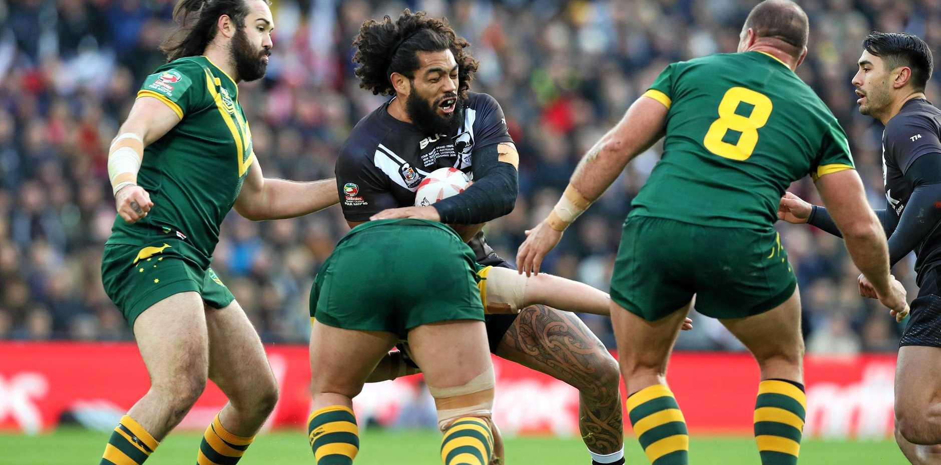 New Zealand's Adam Blair is wrapped up by Australia's Aaron Woods (left) and Matthew Scott during the final of the Four Nations in Liverpool.