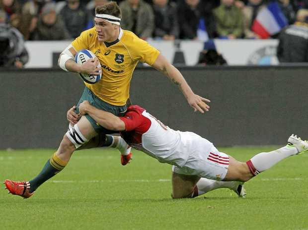 Australia's Sean McMahon is tackled by France's Jean-Marc Doussain during their Test match at the Stade de France in Paris.