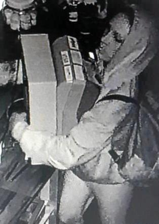 A CCTV image of a thief who stole a cash register and mobile phone from a Mackay business on Monday.