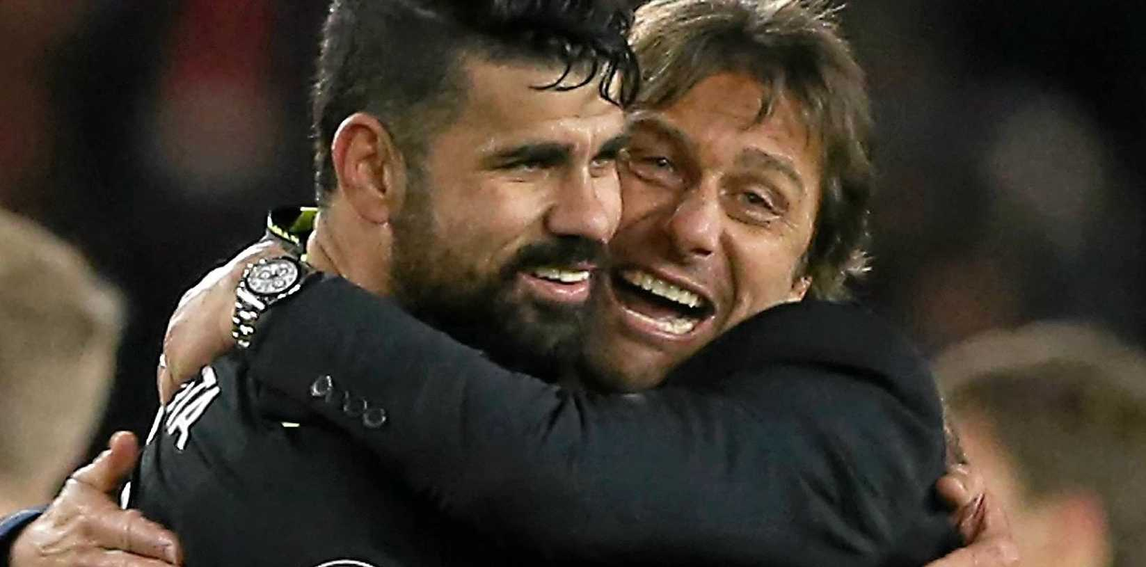 Chelsea manager Antonio Conte (right) congratulates striker Diego Costa after the English Premier League soccer match against Middlesbrough.