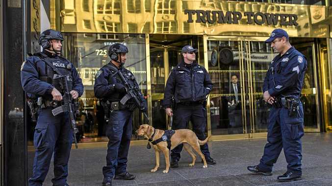TIGHT SECURITY: Police stand guard outside Trump Tower in New York.