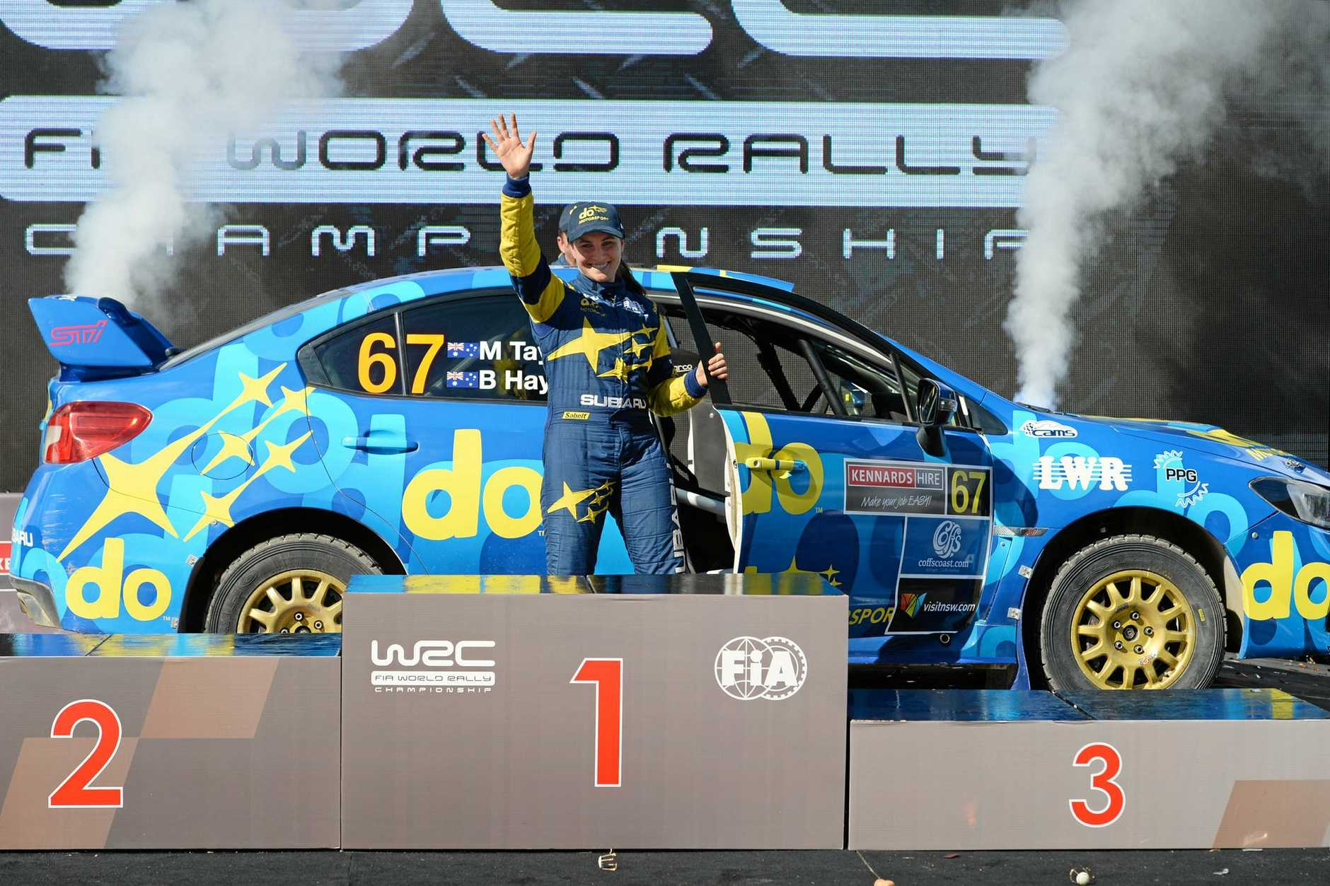 Molly Taylor celebrates on the podium during the Rally Australia at Coffs Harbour.