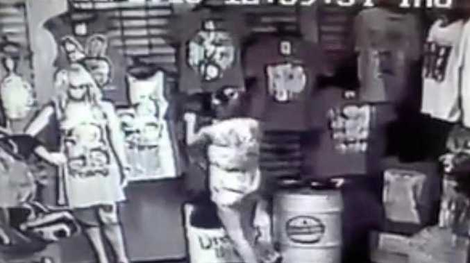 CAUGHT ON CAMERA: One of the girls caught on CCTV cameras stealing a shirt from the Happy Herb Shop in East St.