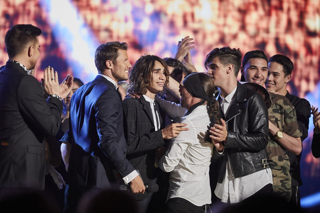 The X Factor winner Isaiah Firebrace is congratulated by his fellow contestants and judges.