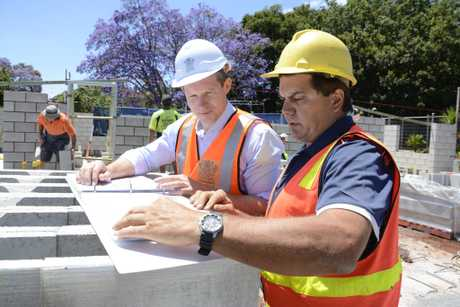 IN THE WORKS: State Works and Public Housing Minister Mick de Brenni inspects new units being built on Ruthven St with project manager Paul White from Ray Weston Construction.