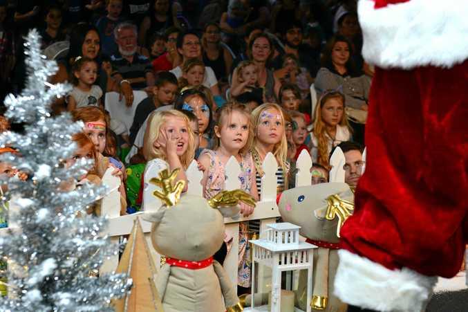 CHRISTMAS FUN: Santa and the magician entertain children at Sunshine Plaza for the arrival of Santa.