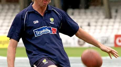 Australian bowler Glenn McGrath kicks a ball at The Oval in 2005.