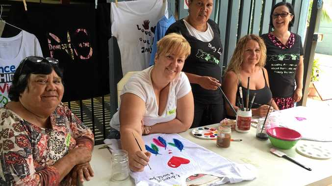Aunty Irene from Aboriginal Womens Refuge Bugalma Bihyn with vounteers Bec, Maryanne, Lorraine and manager, Jillian Knight-Smith from Women Up North Housing, painting tee-shirts to go on display in Lismore's CBD for Dirty Laundry's 16 days of activisim.