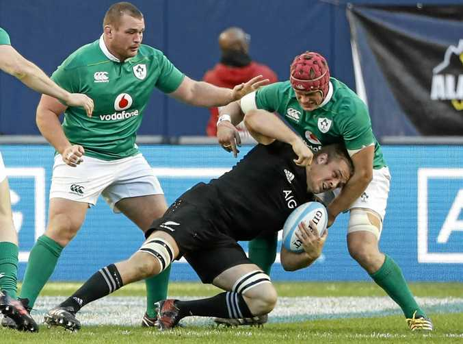 Ireland's Josh van der Flier (right) tackles New Zealand's Sam Cane.