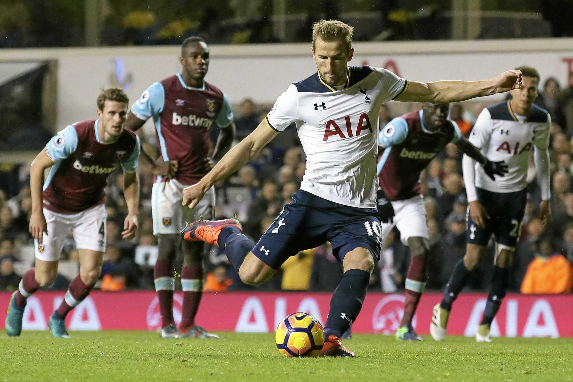 Tottenham's Harry Kane scores a penalty during the English Premier League match against West Ham.