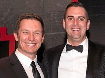 Rove McManus (left) presents Grant Smith (centre) with one of the real estate industry's top awards. Grant's sale executive Jacqui Mullins is on the right.