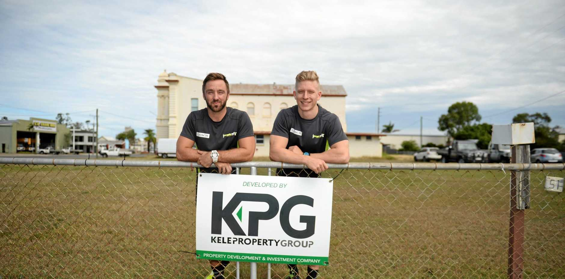 FITNESS CENTRE: Sean O'Neill and Jake Standen at the site of a new gym. INSET: Artist's impressions of the health and fitness precinct.