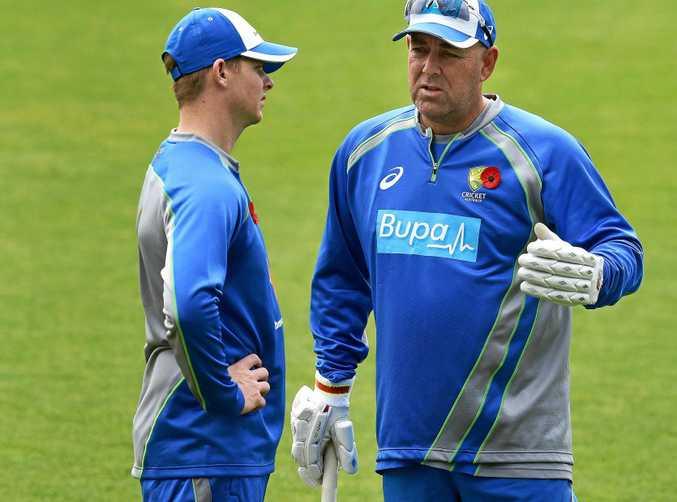 Australian captain Steve Smith chats with coach Darren Lehmann during an Australian team training session.