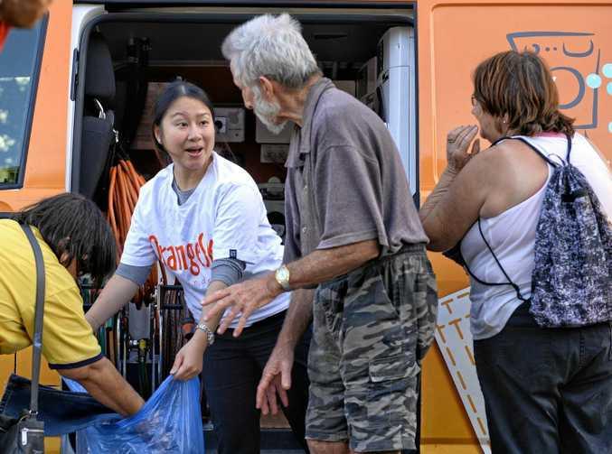 Volunteer Dao Pham helps out at the Orange Sky laundry van in Ipswich.