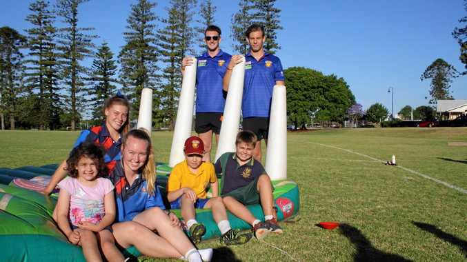 LIONS KINGS: Brisbane Lions players Daniel McStay and Josh Clayton (back) with Izzy Anderton, Caitlin Banks, Monty Anderson, Flynn Ross and Connor Lloyd at an event to open the new AFL Darling Downs office at Concordia Lutheran College.