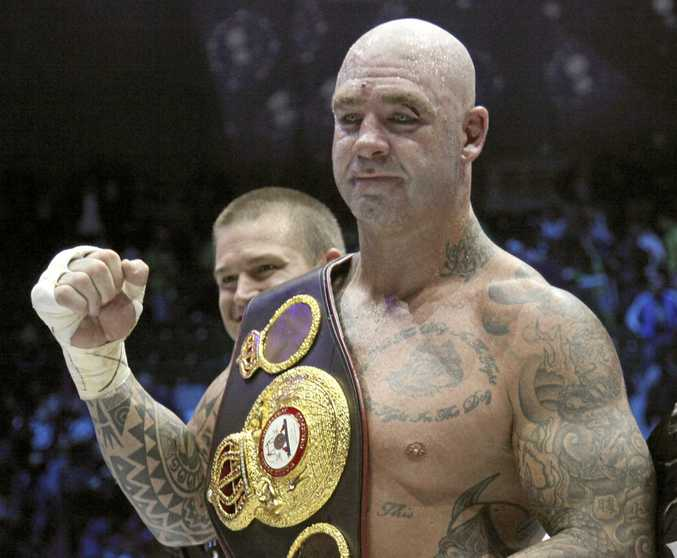 Australia's Lucas Browne celebrates his victory over Uzbekistan's Ruslan Chagaev in their WBA world heavyweight boxing title match in Chechnya. He was later stripped of the belt.