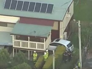 Car driven through fence and into house