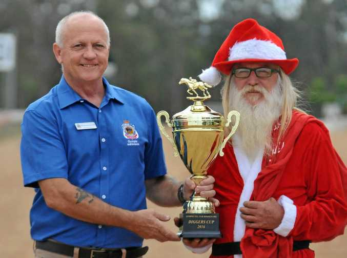 READY TO RACE: Peter Maddocks and Santa (aka Colin Betts) prepare for a big race day in Gympie this Saturday.