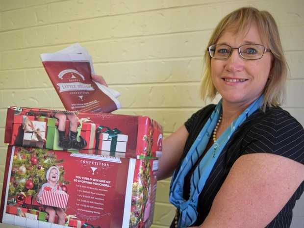 BUY LOCAL: CQ News general manager Karin-ane King with an entry to the Santa's Little Helper competition.