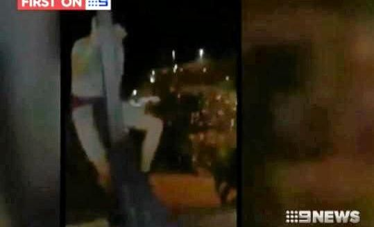 Nine News vision of a schoolie in Airlie Beach jumping from a balcony.
