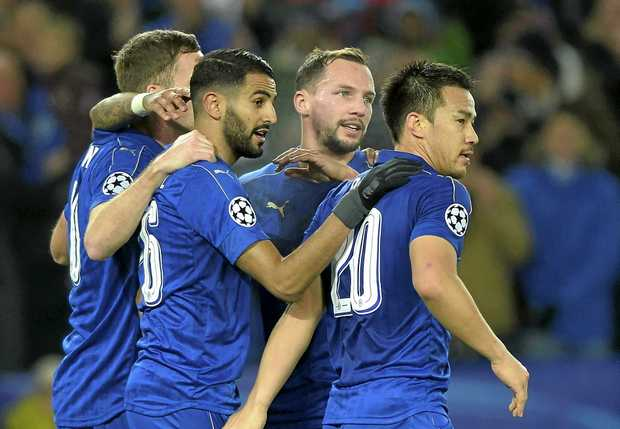 Shinji Okazaki (right) and Riyad Mahrez (second from right) celebrate with Leicester City teammates  at the King Power Stadium in London