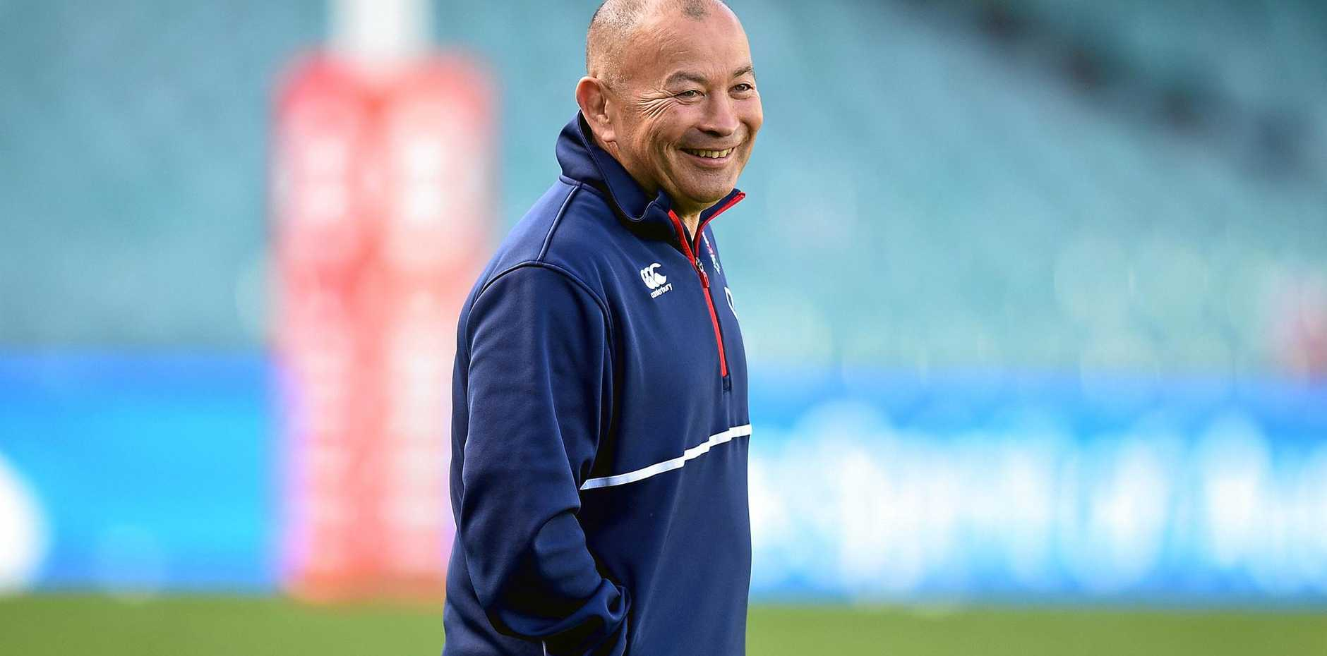 England rugby coach Eddie Jones is all smiles at a training run.