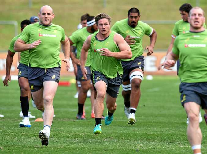 Wallabies flanker Michael Hooper (centre) puts in the hard yards during a training run ahead of this weekend's clash against Ireland.