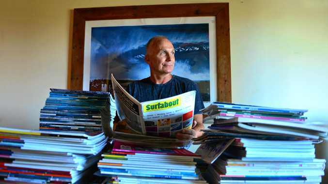 PARTING WORDS: Noel Woods with the collection of surf magazines from the 1960s to 1990s that he has decided to sell.