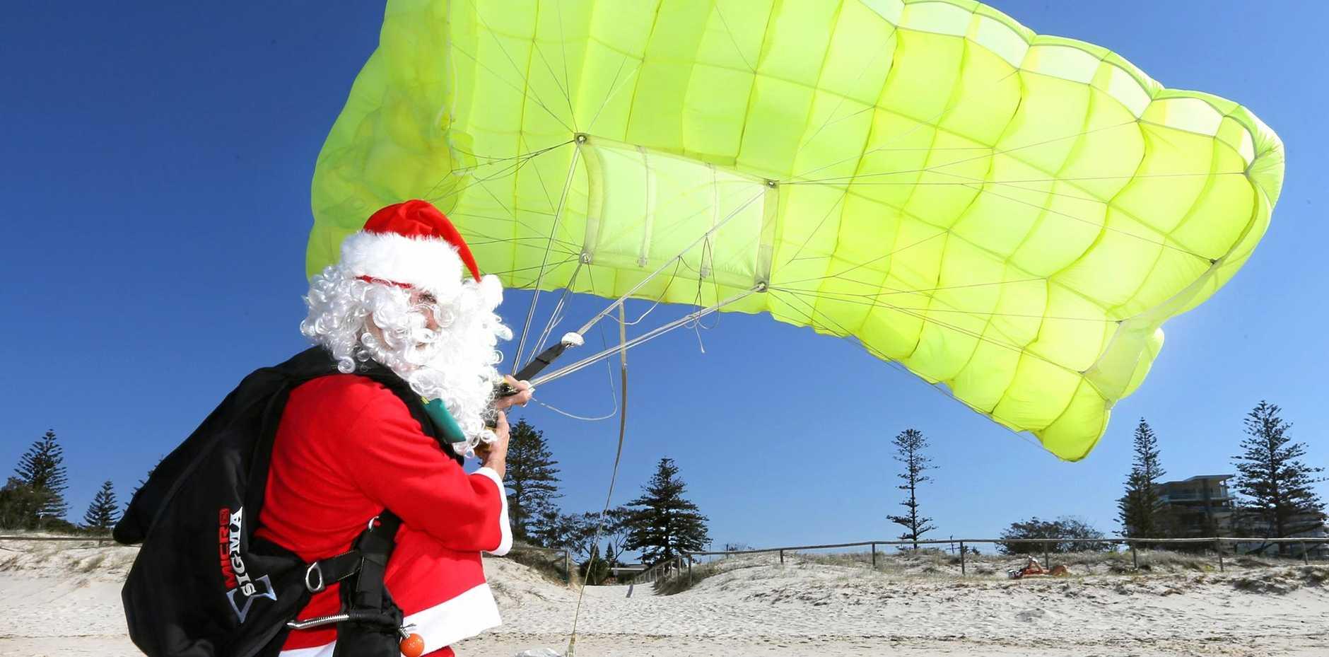 Santa gets ready to skydive into the Coolangatta Christmas Carols on Sunday, December 13. Photo: Scott Powick Daily News