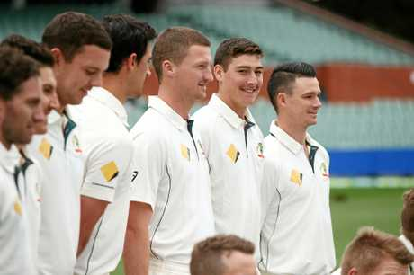 MAN IN THE MIDDLE: Matt Renshaw and the Australians  pose for a team photo.