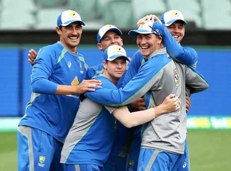 WELCOME ABOARD: Players, including Matt Renshaw, celebrate during a training drill during an Australian nets session