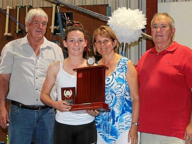 IN MEMORY: Grant Onions Memorial Trophy recipient Annabelle Kerle with Jenny and Mick Onions and club president Michael Fehlhaber.
