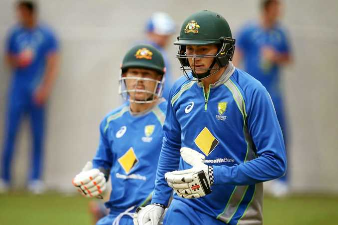 : Matt Renshaw walks up to bat in the nets with David Warner during an Australian nets session at Adelaide Oval.