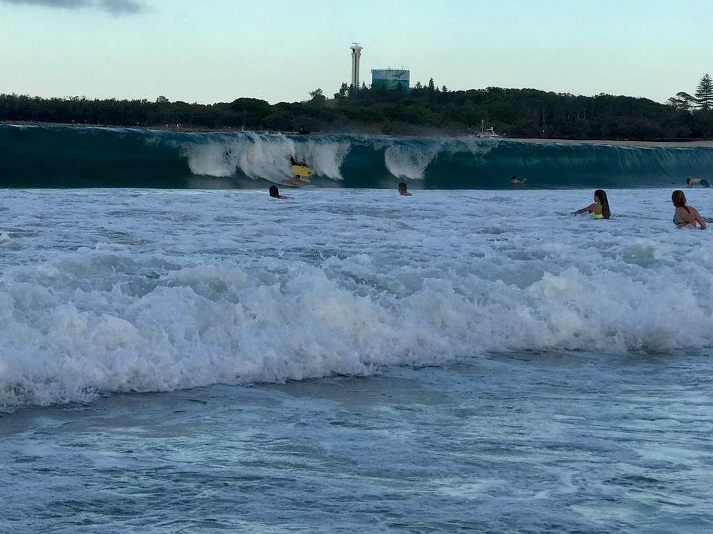 Surfers and body boarders make the most of the waves at Mooloolaba.