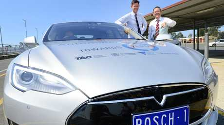 The minister for Main Roads and Road Safety Mark Bailey MP with member for Ipswich West Jim Madden at the launch of the automated driving project.