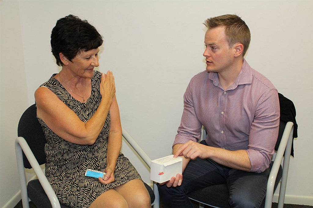 TECHNIQUE: Golden Beach Medical Centre's Dr Peter De Wet (right) explains to USC Clinical Trials Centre research coordinator Jo McFarland how the cannabidiol is applied to the shoulder.