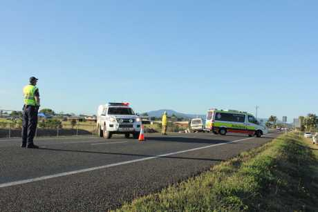 An ambulance leaves for Proserpine Hospital with the driver of a light truck on board.