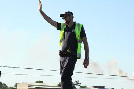 Proserpine Police direct traffic at the scene on the Bruce Hwy.