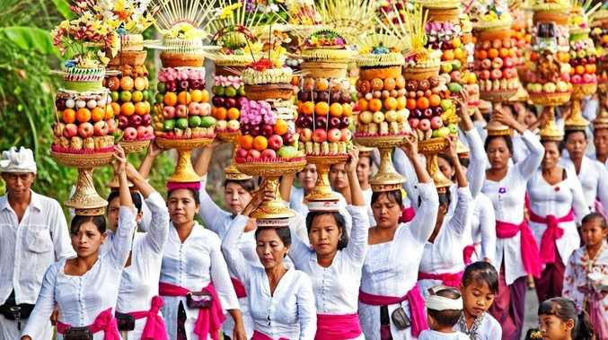 A SIGHT TO BEHOLD: A group of Balinese carry elaborate and colourful offerings on their way to a special temple ceremony.
